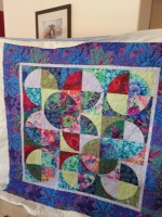 My friend Carrie's first EVER quilt!! made for a very good friend recovering from cancer. Drunkards Path quilt made with beautiful Kaffe Fassett fabrics.